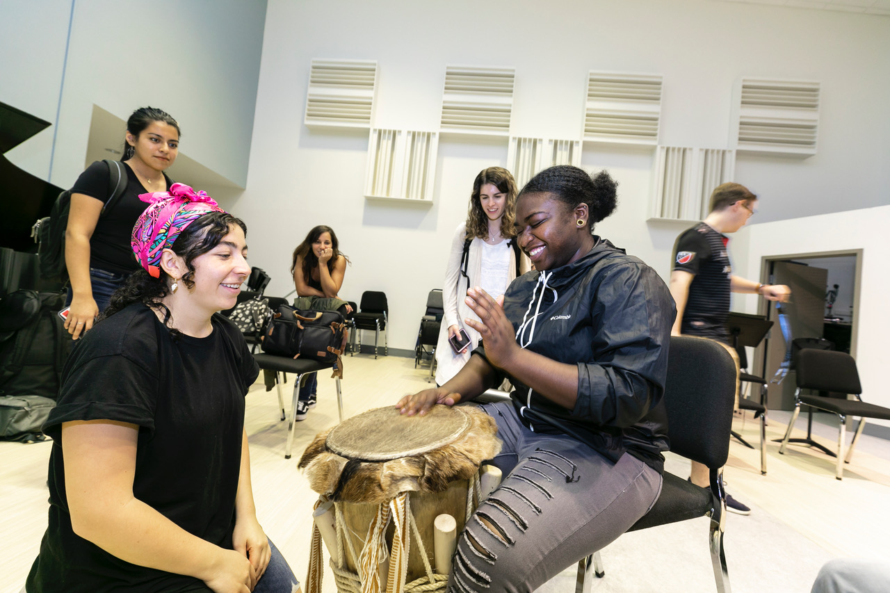 LADAMA holding a drumming workshop for percussion students at Manassas Park High School and Mason students enrolled in World Music Classes.